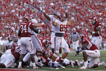 FAYETTEVILLE - SEPTEMBER 25: Alabama Crimson Tide players celebrate after Mark Ingram (not pictured) scored the game winning touchdown against the Arkansas Razorbacks at Donald W. Reynolds Razorback Stadium on September 25, 2010 in Fayetteville, Arkansas.