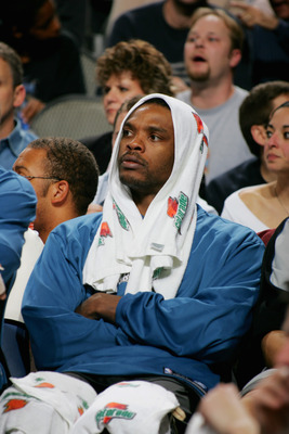 DALLAS - NOVEMBER 22:  Latrell Sprewell #8 of the Minnesota Timberwolves watches the game against the Dallas Mavericks at American Airlines Arena on November 22, 2004 in Dallas, Mavericks.  The Wolves won 83-82.  NOTE TO USER: User expressly acknowledges