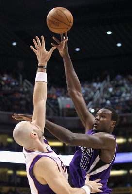 PHOENIX, AZ - FEBRUARY 13:  Samuel Dalembert #10 of the Sacramento Kings puts up a shot over Marcin Gortat #4 of the Phoenix Suns during the NBA game at US Airways Center on February 13, 2011 in Phoenix, Arizona. The Kings defeated the Suns 113-108.  NOTE