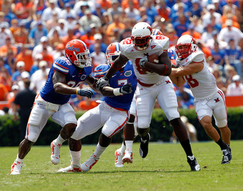 Ronald Powell (No. 7) makes a tackle during his freshman year.