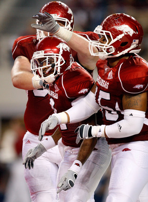 ARLINGTON, TX - OCTOBER 03:  Wide receiver Jarius Wright #4 of the Arkansas Razorbacks celebrates a touchdown pass reception against the Texas A&M Aggies at Dallas Cowboys Stadium on October 3, 2009 in Arlington, Texas.  (Photo by Ronald Martinez/Getty Im