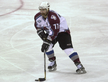 21 May 2001: Ray Bourque #77 of the Colorado Avalanche takes the puck down the ice in the third period of game five of the Western Conference Finals. Joe Sakic of theAvalanche scored the goal in overtime to defeat the St.Louis Blues 2-1 at the Pepsi Cente