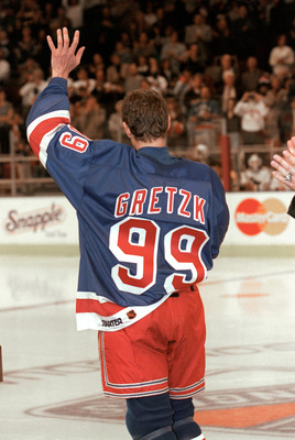 NEW YORK, NY - APRIL 18:  Wayne Gretzky #99 of the New York Rangers waves to the crowd during introductions before his final career game against the Pittsburgh Penguins at the Madison Square Garden on April 18, 1999 in New York City, New York.  Gretzky pl