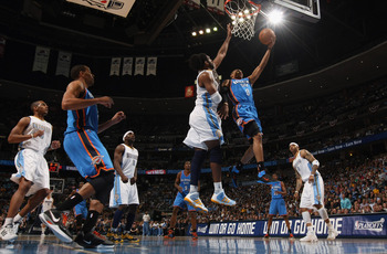 DENVER, CO - APRIL 25:  Russell Westbrook #0 of the Oklahoma City Thunder lays up a shot against Nene Hilario #31 of the Denver Nuggets in Game Four of the Western Conference Quarterfinals in the 2011 NBA Playoffs on April 24, 2011 at the Pepsi Center in
