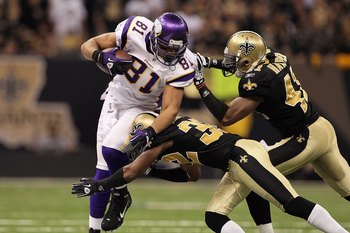 NEW ORLEANS - JANUARY 24:  Visanthe Shiancoe #81 of the Minnesota Vikings runs for yards after the catch against Jabari Greer #32 and Roman Harper #41 of the New Orleans Saints during the NFC Championship Game at the Louisiana Superdome on January 24, 201