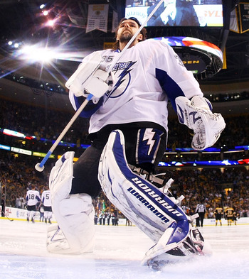 BOSTON, MA - MAY 27:  Dwayne Roloson #35 of the Tampa Bay Lightning prepares for Game Seven of the Eastern Conference Finals against the Boston Bruins during the 2011 NHL Stanley Cup Playoffs at TD Garden on May 27, 2011 in Boston, Massachusetts.  (Photo