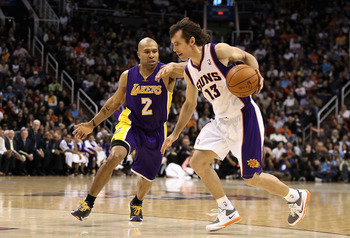 PHOENIX, AZ - JANUARY 05:  Steve Nash #13 of the Phoenix Suns hanldes the ball under pressure from Derek Fisher #2 of the Los Angeles Lakers during the NBA game at US Airways Center on January 5, 2011 in Phoenix, Arizona. The Lakers defeated the Suns 99-9