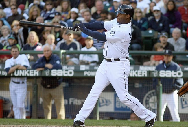 SEATTLE - SEPTEMBER 20: Ken Griffey Jr.#24 of the Seattle Mariners swings at the pitch during the game against the New York Yankees on September 20, 2009 at Safeco Field in Seattle, Washington. (Photo by Otto Greule Jr/Getty Images)