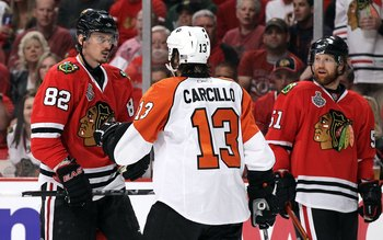 CHICAGO - MAY 31:  Tomas Kopecky #82 of the Chicago Blackhawks and Daniel Carcillo #13 of the Philadelphia Flyers argue in the first period of Game Two of the 2010 NHL Stanley Cup Final at the United Center on May 31, 2010 in Chicago, Illinois.  (Photo by