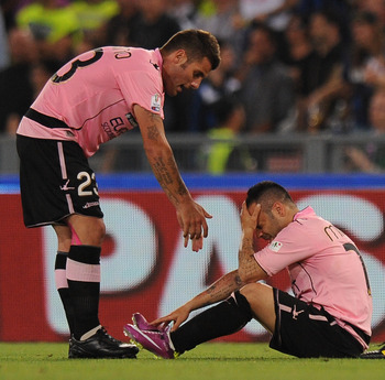 ROME, ITALY - MAY 29:  Fabrizio Miccoli (R)  of Palermo shows his dejection as Antonio Nocerino reacts after losing the Tim Cup final between FC Internazionale Milano and US Citta di Palermo at Olimpico Stadium on May 29, 2011 in Rome, Italy.  (Photo by T