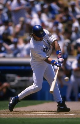 8 Jul 1996:  Catcher Mike Piazza of the Los Angeles Dodgers focuses on the ball as he begins his swing during an at-bat in the Dodgers 3-0 loss to the Colorado Rockies at Dodger Stadium in Los Angeles, California.  Mandatory Credit: Jed Jacobsoh  /Allspor