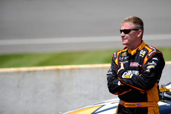 BROOKLYN, MI - JUNE 18:  Jeff Burton, driver of the #31 Caterpillar Chevrolet, stands on pit road during qualifying for the NASCAR Sprint Cup Series Heluva Good! Sour Cream Dips 400 at Michigan International Speedway on June 18, 2011 in Brooklyn, Michigan