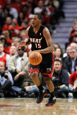 CHICAGO, IL - MAY 15:  Mario Chalmers #15 of the Miami Heat brings the ball up court against the Chicago Bulls in Game One of the Eastern Conference Finals during the 2011 NBA Playoffs on May 15, 2011 at the United Center in Chicago, Illinois. The Bulls w