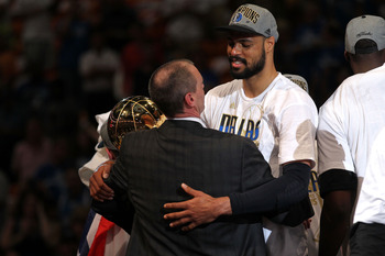 MIAMI, FL - JUNE 12: (L-R) Head coach Rick Carlisle and Tyson Chandler #6 of the Dallas Mavericks celebrate after the Mavericks won 105-95 against the Miami Heat in Game Six of the 2011 NBA Finals at American Airlines Arena on June 12, 2011 in Miami, Flor