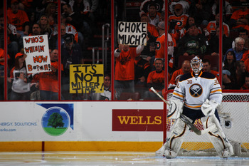 PHILADELPHIA, PA - APRIL 22:  Philadelphia Flyers fans hold up signs behind goalie Ryan Miller #30 of the Buffalo Sabres during the third period of Game Five of the Eastern Conference Quarterfinals during the 2011 NHL Stanley Cup Playoffs at Wells Fargo C