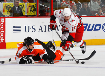 PHILADELPHIA - NOVEMBER 01:  Daniel Carcillo #13 of the Philadelphia Flyers falls to the ice battling for the puck against Tuomo Ruutu #15 of the Carolina Hurricanes on November 1, 2010 at the Wells Fargo Center in Philadelphia, Pennsylvania. Flyers defea