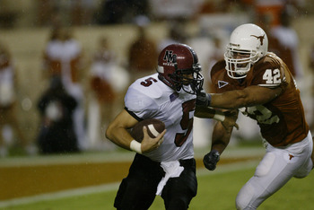 AUSTIN, TX - AUGUST 31:  Quarterback Joey Vincent #5 of the New Mexico State University Aggies is tackled for a loss by defensive end Chase Pittman #42 of the University of Texas at Austin Longhorns at Texas Memorial Stadium on August 31, 2003 in Austin,