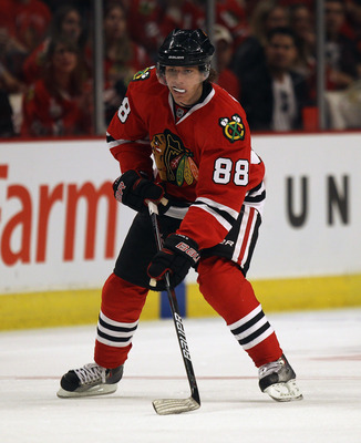 CHICAGO, IL - APRIL 10: Patrick Kane #88 of the Chicago Blackhawks controls the puck against the Detroit Red Wings at the United Center on April 10, 2011 in Chicago, Illinois. The Red Wings defeated the Blackhawks 4-3. (Photo by Jonathan Daniel/Getty Imag