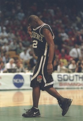 23 Mar 1997:  Guard God Shammgod of the Providence Friars wipes his eyes with jersey after a playoff game against the Arizona Wildcats at the Birmingham-Jefferson Civic Center, in Birmingham, Alabama.  The Wildcats won the game 96-92..  Mandatory Credit: