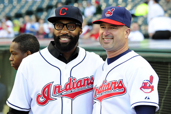 CLEVELAND, OH - JUNE 2:  (L-R) Cleveland Cavaliers guard Baron Davis poses for a photo with Cleveland Indians Manager Manny Acta #11 of the Cleveland Indians at Progressive Field on June 2, 2011 in Cleveland, Ohio. (Photo by Jason Miller/Getty Images)