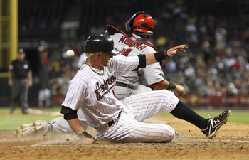 HOUSTON - JUNE 08:  J.R. Towles #46 of the Houston Astros slides safely into home plate in the eighth inning as catcher Yadier Molina #4 of the St. Louis Cardinals awaits the ball at Minute Maid Park on June 8, 2011 in Houston, Texas.  (Photo by Bob Levey