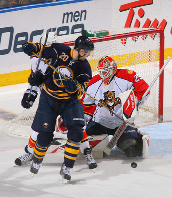 BUFFALO, NY - MARCH 25: Tomas Vokoun #29 of the Florida Panthers makes a save behind Rob Niedermayer #20 of the Buffalo Sabres at HSBC Arena on March 25, 2011 in Buffalo, New York.  (Photo by Rick Stewart/Getty Images)