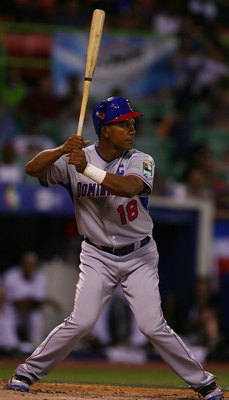 SAN JUAN, PUERTO RICO - MARCH 10:  Moises Alou #18  of The Dominican Republic bats against The Netherlands during the 2009 World Baseball Classic Pool D match on March 10, 2009 at Hiram Bithorn Stadium in San Juan, Puerto Rico.  (Photo by Al Bello/Getty I