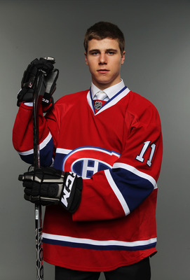ST PAUL, MN - JUNE 24:  17th overall pick Nathan Beaulieu by the Montreal Canadiens poses for a portrait during day one of the 2011 NHL Entry Draft at Xcel Energy Center on June 24, 2011 in St Paul, Minnesota.  (Photo by Nick Laham/Getty Images)