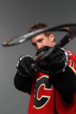 ST PAUL, MN - JUNE 24:  13th overall pick Sven Baertschi by the Calgary Flames poses for a portrait during day one of the 2011 NHL Entry Draft at Xcel Energy Center on June 24, 2011 in St Paul, Minnesota.  (Photo by Nick Laham/Getty Images)