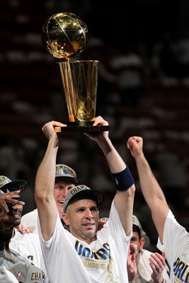 MIAMI, FL - JUNE 12:  Jason Kidd #2 of the Dallas Mavericks holds up the Larry O'Brien Championship trophy as he celebrates with his teammates after they won 105-95 against the Miami Heat in Game Six of the 2011 NBA Finals at American Airlines Arena on Ju