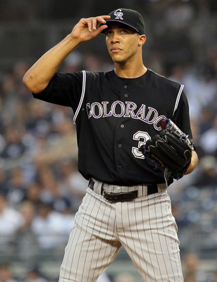 NEW YORK, NY - JUNE 24:  Ubaldo Jimenez #38 of the Colorado Rockies looks on against the New York Yankees on June 24, 2011 at Yankee Stadium in the Bronx borough of New York City.  (Photo by Jim McIsaac/Getty Images)