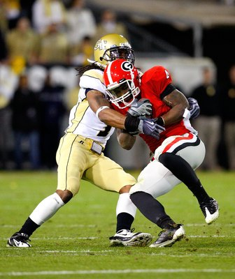 ATLANTA - NOVEMBER 28:  Morgan Burnett #1 of the Georgia Tech Yellow Jackets against Caleb King #4 of the Georgia Bulldogs at Bobby Dodd Stadium on November 28, 2009 in Atlanta, Georgia.  (Photo by Kevin C. Cox/Getty Images)