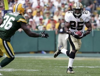 GREEN BAY, WI - SEPTEMBER 17:  Reggie Bush #25 of the New Orleans Saints carries the ball as Nick Collins #36 of the Green Bay Packers defends on September 17, 2006 at Lambeau Field in Green Bay, Wisconsin. The New Orleans Saints defeated the Green Bay Pa