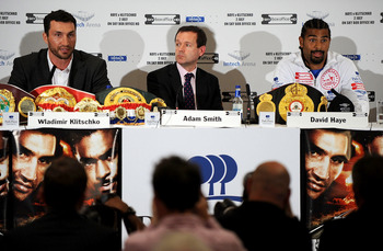 LONDON, ENGLAND - MAY 10:  David Haye listens to Wladimir Klitschko as he talks to the press during the David Haye v Wladimir Klitschko Press Conference at the Park Plaza Hotel on May 10, 2011 in London, England.  (Photo by Christopher Lee/Getty Images)