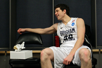 DENVER, CO - MARCH 19:  Jimmer Fredette #32 of the Brigham Young Cougars sits in the locker room after defeating the Gonzaga Bulldogs during the third round of the 2011 NCAA men's basketball tournament at Pepsi Center on March 19, 2011 in Denver, Colorado