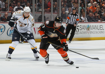 ANAHEIM, CA - APRIL 13:  Lubomir Visnovsky #17 of the Anaheim Ducks is pursued by Sergei Kostitsyn #74 of the Nashville Predators for the puck in the first period of Game One of the Western Conference Quarterfinals during the 2011 NHL Stanley Cup Playoffs