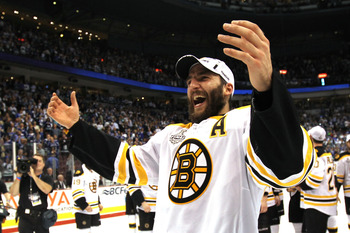 VANCOUVER, BC - JUNE 15:  Patrice Bergeron #37 of the Boston Bruins celebrates winning the Stanley Cup after defeating the Vancouver Canucks in Game Seven of the 2011 NHL Stanley Cup Final at Rogers Arena on June 15, 2011 in Vancouver, British Columbia, C
