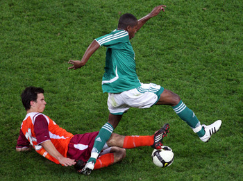 BRISBANE, AUSTRALIA - JULY 12:  Alberto De Paula of  Palmeiras is tackled by Tim Smits of the Roar during the friendly match between the Queensland Roar and Palmeiras at Suncorp Stadium on July 12, 2008 in Brisbane, Australia.  (Photo by Bradley Kanaris/G