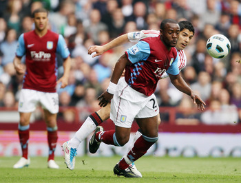 BIRMINGHAM, ENGLAND - MAY 22:  Nigel Reo-Coker of Aston Villa battles with Luis Suarez of Liverpool during the Barclays Premier League match between Aston Villa and Liverpool at Villa Park on May 22, 2011 in Birmingham, England.  (Photo by Bryn Lennon/Get