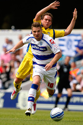 LONDON, ENGLAND - MAY 07:  Akos Buzsaky (front) of QPR in action against Neil Kilkenny of Leeds during the npower Championship match between Queens Park Rangers and Leeds United at Loftus Road on May 7, 2011 in London, England.  (Photo by Dan Istitene/Get