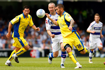 LONDON, ENGLAND - MAY 07:  Shaun Derry (L) of QPR in action against Bradley Johnson of Leeds during the npower Championship match between Queens Park Rangers and Leeds United at Loftus Road on May 7, 2011 in London, England.  (Photo by Dan Istitene/Getty