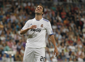 MADRID, SPAIN - MAY 10: Gonzalo Higuain of Real Madrid reacts during the La Liga match between Real Madrid and Getafe at Estadio Santiago Bernabeu on May 10, 2011 in Madrid, Spain. (Photo by Angel Martinez/Getty Images)