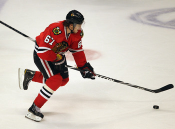 CHICAGO, IL - APRIL 19:Michael frolik #67 of the Chicago Blackhawks skates up the ice against the Vancouver Canucks in Game Four of the Western Conference Quarterfinals during the 2011 NHL Stanley Cup Playoffs at the United Center on April 19, 2011 in Chi