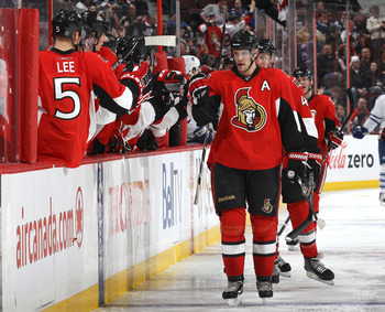 OTTAWA, CANADA - APRIL 2: Jason Spezza #19 of the Ottawa Senators celebrates his second goal of the game with team mate Brian Lee #5 against the Toronto Maple Leafs at Scotiabank Place on April 2, 2011 in Ottawa, Ontario, Canada.  (Photo by Jana Chytilova