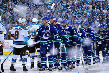 VANCOUVER, BC - MAY 24:  Captain Henrik Sedin #33 of the Vancouver Canucks shakes hands with Joe Pavelski #8 of the San Jose Sharks after the Vancouver Canucks won Game Five of the Western Conference Finals 3-2 in the second overtime to win the series 4-1