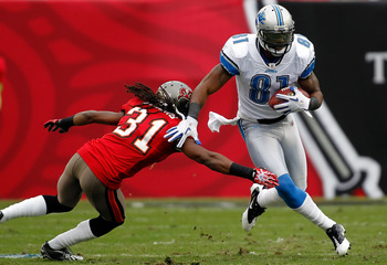 TAMPA, FL - DECEMBER 19:  Receiver Calvin Johnson #81 of the Detroit Lions runs through the tackle of defensive back E.J. Biggers #31 of the Tampa Bay Buccaneers during the game at Raymond James Stadium on December 19, 2010 in Tampa, Florida.  (Photo by J