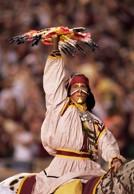 TALLAHASSEE, FL - SEPTEMBER 05:  FSU mascot Chief Osceola and his horse Renegade of the Florida State Seminoles prepares to plant a spear to start the game against the Miami Hurricanes at Doak Campbell Stadium on September 5, 2005 in Tallahassee, Florida.