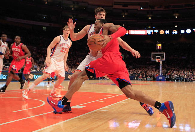 NEW YORK, NY - FEBRUARY 06:  Andre Iguodala #9 of the Philadelphia 76ers drives against Danilo Gallinari #8 of the New York Knicks at Madison Square Garden on February 6, 2011 in New York City. NOTE TO USER: User expressly acknowledges and agrees that, by