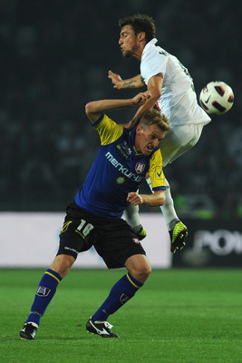 TURIN, ITALY - MAY 09:  Claudio Marchisio of Juventus FC clashes with Luca Rigoni of AC Chievo Verona during the Serie A match between Juventus FC and AC Chievo Verona at Olimpico Stadium on May 9, 2011 in Turin, Italy.  (Photo by Valerio Pennicino/Getty