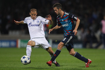 LYON, FRANCE - SEPTEMBER 14:  Miralem Pjanic (r) of Lyon feeds a passes Peer Kluge (l) closes in during the UEFA Champions League Group B match between Olympique Lyonnais and FC Schalke 04 at the Stade de Gerland on September 14, 2010 in Lyon, France.  (P
